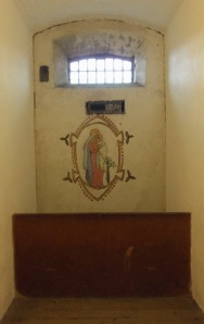 Grace Plunkett's cell with Madonna and Child mural.